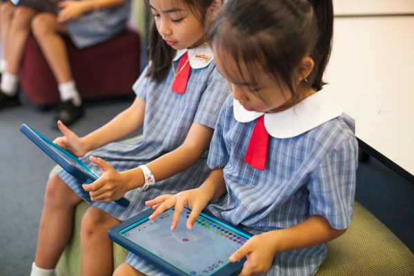 Two students using tablets for enriched learning